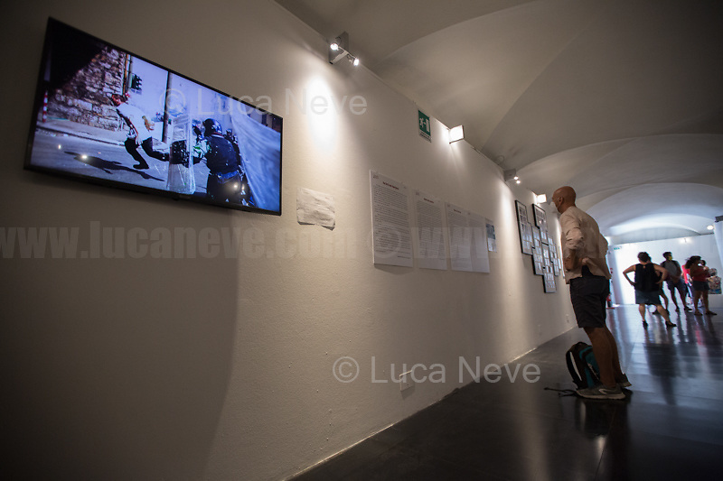 """""""Cassandra - Genova 2001 Genova 2021"""", exhibition.<br /> <br /> Genoa, Italy. 19, 20, 21 July 2021. Twenty years after the dramatic and terrifying events related to the 2001 Genoa's G8 meeting, according to Amnesty International: """"the most serious suspension of democratic rights in a Western country since the Second World War"""" (1.) and as stated on the 2001 """"Report on the situation of fundamental rights in the EU"""" the European Parliament """"deplores the suspensions of fundamental rights that took place during public demos, and in particular at the G8 meeting in Genoa, such as freedom of expression, freedom of movement, the right to physical integrity"""" (2.). As a reminder, the City of Genoa is State Gold Medal (Medaglia D'Oro) for its Antifascist Resistance in World War II.<br /> Some photos, part of this story, are presented appositely in Black & White to show to the audience """"the Places"""" where the majority of - the already mentioned (see above) - """"suspensions of fundamental rights […] such as freedom of expression, freedom of movement, the right to physical integrity"""" (2.) happened.<br /> In these three days, throughout a series of events, Genoa and its People, survivors and witnesses, experts and activists, remembered what happened 20 years ago, discussed the present situation of a world dominated by """"casino capitalism"""", predatory neo-liberalism, wars, rightless globalization, ...<br /> <br /> FULL CAPTION AT THE BEGINNING OF THIS STORY.<br /> <br /> Footnotes, Links, Sources:<br /> <br /> 1. http://bit.do/fRvdg<br /> 2. http://bit.do/fRvdi<br /> 3. http://bit.do/fRvdj<br /> 4. http://bit.do/fRvdn<br /> 5. http://bit.do/fRvdo<br /> 6. http://bit.do/fRvdr<br /> 7. http://bit.do/fRvdt & http://bit.do/fRvdu<br /> 8. http://bit.do/fRvdv & http://bit.do/fRvdw & http://bit.do/fRvdx<br /> 9. http://bit.do/fRvdz<br /> 10. http://bit.do/fRvdA<br /> 11. http://bit.do/fRvdB<br /> http://www.veritagiustizia.it/doc_eng/<br /> https://www.carlogiuliani.it<br /> https://en.wikiped"""