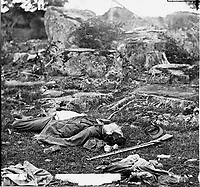 """Gettysburg, Pa. Dead Confederate soldiers in """"the devil's den""""].<br /> Photograph from the main eastern theater of the war, Gettysburg, June-July, 1863."""