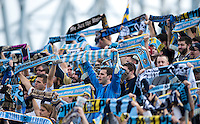 Philadelphia fans hold their team scarves high during the game at PPL Park in Chester, PA.  New York defeated Philadelphia, 3-0.