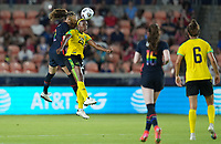 HOUSTON, TX - JUNE 13: Tierna Davidson #12 of the United States and Cheyna Matthews #20 of Jamaica battle during a game between Jamaica and USWNT at BBVA Stadium on June 13, 2021 in Houston, Texas.