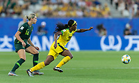 GRENOBLE, FRANCE - JUNE 18: Cheyna Matthews #20 of the Jamaican National Team attempts to control the ball during a game between Jamaica and Australia at Stade des Alpes on June 18, 2019 in Grenoble, France.