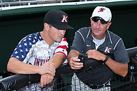 Kannapolis Intimidators Head Groundskeeper Billy Ball (right) shows manager Justin Jirschele (9) something on his smart phone prior to the game against the Delmarva Shorebirds at Kannapolis Intimidators Stadium on June 30, 2017 in Kannapolis, North Carolina.  The Shorebirds defeated the Intimidators 6-4.  (Brian Westerholt/Four Seam Images)
