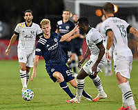 LAKE BUENA VISTA, FL - AUGUST 01: Keaton Parks #55 of New York City FC tries to evade Larrys Mabiala #33 of the Portland Timbers on the dribble during a game between Portland Timbers and New York City FC at ESPN Wide World of Sports on August 01, 2020 in Lake Buena Vista, Florida.