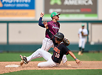 Palm Harbor University Hurricanes Jake Mummau (13) throws to first base as Kade Faircloth (10) slides in during the 42nd Annual FACA All-Star Baseball Classic on June 6, 2021 at Joker Marchant Stadium in Lakeland, Florida.  (Mike Janes/Four Seam Images)