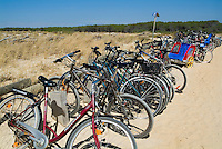 Row of bicycles parked along the beach, Biscarrosse, Aquitaine, France.