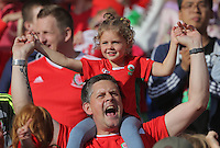 "Pictured: Wales fans at the Cardiff City Stadium Friday 08 July 2016<br /> Re: Thousands of fans are expected to line the streets to welcome back the Wales national team. An open top bus will parade through Cardiff, from Cardiff Castle to Cardiff City Stadium where the Manic Street Preachers will play to 33,000 people.<br /> The parade comes after Wales lost 2-0 to Portugal in the semi-final on Wednesday, with their historic run hailed as a performance which has ""changed Welsh football forever""."