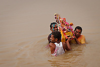 "Ganesh Chaturthi, An annual festival honours Ganesha for ten days. The festival begins with people bringing in clay idols of Ganesha, symbolising Ganesha's visit. The festival culminates on the day of Ananta Chaturdashi, when idols (murtis) of Ganesha are immersed in the most convenient body of water, while the people shout ""Ganapati Bappa Morya"" (Ganesh come back soon next year). Some families have a tradition of immersion on the 3rd, 5th, or 7th day. On the 11th day, the statue is taken through the streets in a procession accompanied with dancing, singing, and fanfare to be immersed in a river or the sea symbolizing a ritual see-off of the Lord in his journey towards his abode in Kailash while taking away with him the misfortunes of his devotees"