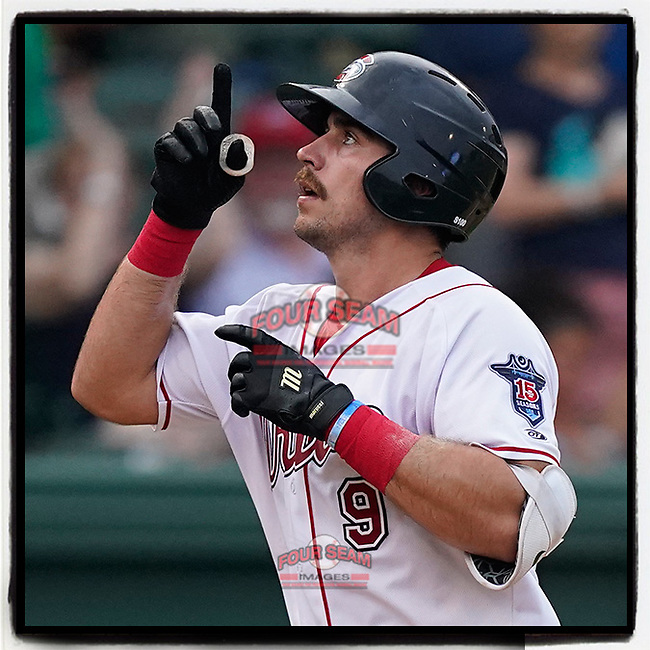 Catcher Kole Cottam (9) of the Greenville Drive points skyward as he crosses the plate with a home run in a game against the Greensboro Grasshoppers on Thursday, July 22, 2021, at Fluor Field at the West End in Greenville, South Carolina. (Tom Priddy/Four Seam Images)