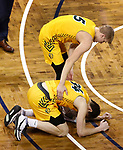SIOUX FALLS, SD - MARCH 9: Sam Griesel #5 of the North Dakota State Bison consoles teammate Rocky Kreuser #34 after their loss to Oral Roberts during the 2021 Men's Summit League Basketball Championship at the Sanford Pentagon in Sioux Falls, SD. (Photo by Richard Carlson/Inertia)