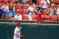 Buffalo Bisons first baseman Casey Kotchman (55) flips a ball to kids in the stands during a game against the Louisville Bats on June 23, 2016 at Coca-Cola Field in Buffalo, New York.  Buffalo defeated Louisville 9-6.  (Mike Janes/Four Seam Images)