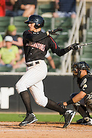 Trayce Thompson #24 of the Kannapolis Intimidators follows through on his swing against the West Virginia Power at Fieldcrest Cannon Stadium April 25, 2010, in Kannapolis, North Carolina.  Photo by Brian Westerholt / Four Seam Images