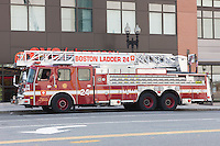 Boston Fire Department Ladder 24 responding to a call on Causeway Street.  Ladder 24 is a 2010 E-One Cyclone II 110' Rear Mount Aerial Unit.