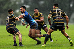 George Edwards of Howick is tackled. Fox Memorial Rugby League, Northcote Tigers v Howick Hornets, Birkenhead War Memorial Park Auckland, Saturday 22nd July 2017. Photo: Simon Watts / www.bwmedia.co.nz