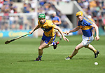 Cathal Mc Inerney of Clare in action against Donagh Maher of Tipperary during their quarter final at Pairc Ui Chaoimh. Photograph by John Kelly.