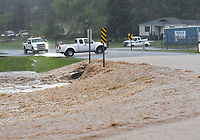 A motorist stops and turns around to avoid  on Wednesday April 28 2021 a flooded section of Arkansas 12 in the Prairie Creek community east of Rogers. Go to nwaonline.com/210429Daily/ to see more photos.<br /> (NWA Democrat-Gazette/Flip Putthoff)
