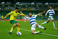 29th December 2020; Carrow Road, Norwich, Norfolk, England, English Football League Championship Football, Norwich versus Queens Park Rangers; Yoann Barbet of Queens Park Rangers slides in and challenges Max Aaron of Norwich City