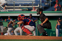 Umpire Justin Juska and Lowell Spinners catcher Elih Marrero (5) during a NY-Penn League game against the Batavia Muckdogs on July 10, 2019 at Dwyer Stadium in Batavia, New York.  Batavia defeated Lowell 8-6.  (Mike Janes/Four Seam Images)