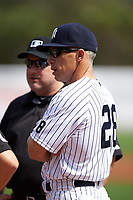 New York Yankees manager Joe Girardi (28) during the lineup exchange before a Spring Training game against the Detroit Tigers on March 2, 2016 at George M. Steinbrenner Field in Tampa, Florida.  New York defeated Detroit 10-9.  (Mike Janes/Four Seam Images)