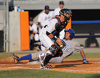 Infielder Michael Antonio (16) of the Burlington Royals slides home safely ahead of the tag by catcher Cam Maron (7) of the Kingsport Mets on August 20, 2011, at Hunter Wright Stadium in Kingsport, Tennessee. Kingsport defeated Burlington, 17-14. (Tom Priddy/Four Seam Images)