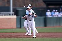 CHAPEL HILL, NC - FEBRUARY 27: Mac Horvath #10 of North Carolina throws to first base during a game between Virginia and North Carolina at Boshamer Stadium on February 27, 2021 in Chapel Hill, North Carolina.
