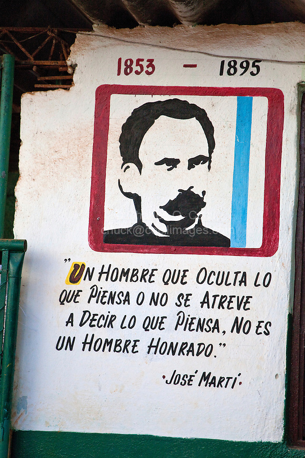 """Cuba, Havana.  Poster and Quotation of Jose Marti: """"A man who hides what he believes, or who doesn't dare to say what he believes, is not an honorable man.""""  Posted in a vegetable market."""