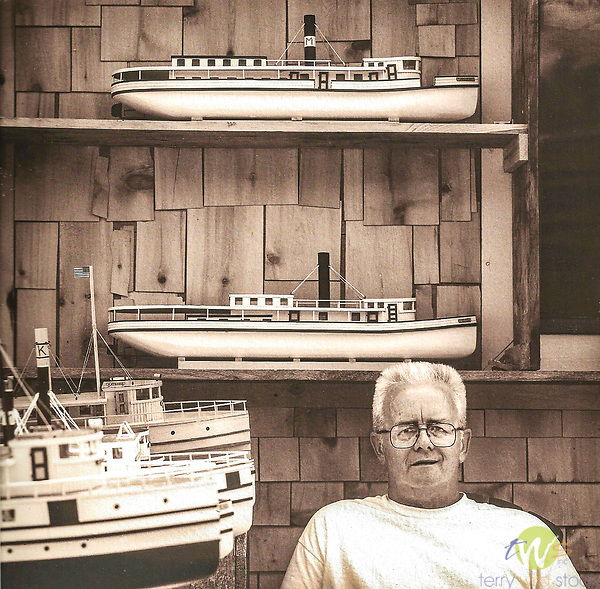 Vintage scan from print. Ship Shape, Peter Templeton, model boat builder, .Greenville, ME. Shop and models. 2011.