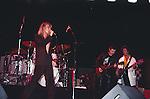 Chris Spedding on stage with Robin Zander, Bun E. Carlos & Jon Brant of Cheap Trick performing live in 1985.