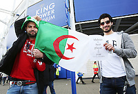 Two fans hold up an Algerian flag in support of Riyad Mahrez before the Barclays Premier League match between Leicester City and Swansea City played at The King Power Stadium, Leicester on April 24th 2016