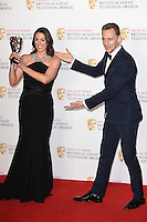 Suranne Jones and Tom Hiddlestone<br /> in the winners room at the 2016 BAFTA TV Awards, Royal Festival Hall, London<br /> <br /> <br /> ©Ash Knotek  D3115 8/05/2016