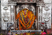 Nepal, Patan.  Shrine inside Hindu temple.