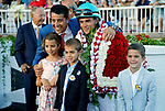 ARLINGTON HEIGHTS, IL - AUGUST 12:  Beach Patrol trainer Chad Brown, his children, and jockey Joel Rosario, pose for a photo in the winner's circle after winning the Arlington Million on Arlington Million Day at Arlington Park on August 12, 2017 in Arlington Heights, Illinois. (Photo by Jon Durr/Eclipse Sportswire/Getty Images)