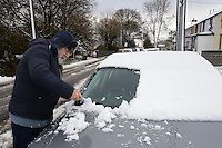 Weather Uk Snow Wales<br /> Sunday 20th November 2016<br /> Resident Leighton Evans clears snow from his car in in the village of Trefil, South Wales