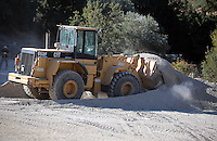 Pictured: A Caterpilar 950 digger, very similar to the one driven by Konstantinos Barkas on the day of Ben Needham's disappearance, operates at the farmhouse site in Kos, Greece. Sunday 09 October 2016<br />Re: Police teams led by South Yorkshire Police, searching for missing toddler Ben Needham on the Greek island of Kos have moved to a new area in the field they are searching.<br />Ben, from Sheffield, was 21 months old when he disappeared on 24 July 1991 during a family holiday.<br />Digging has begun at a new site after a fresh line of inquiry suggested he could have been crushed by a digger.