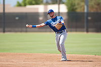 Los Angeles Dodgers second baseman Sam McWilliams (9) throws to first base during an Instructional League game against the Milwaukee Brewers at Maryvale Baseball Park on September 24, 2018 in Phoenix, Arizona. (Zachary Lucy/Four Seam Images)