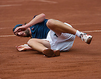 13-08-13, Netherlands, Raalte,  TV Ramele, Tennis, NRTK 2013, National Ranking Tennis Champ,  Sidney de Boer falling down<br /> <br /> Photo: Henk Koster
