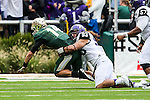 Baylor Bears quarterback Bryce Petty (14) and TCU Horned Frogs defensive end Mike Tuaua (93) in action during the game between the TCU Horned Frogs and the Baylor Bears at the McLane Stadium in Waco, Texas. TCU leads Baylor 31 to 27 at halftime.