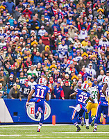 14 December 2014: Buffalo Bills running back Marcus Thigpen returns a 31-yard punt for a 75-yard gain and a touchdown in the first quarter against the Green Bay Packers at Ralph Wilson Stadium in Orchard Park, NY. The Bills defeated the Packers 21-13, snapping the Packers' 5-game winning streak and keeping the Bills' 2014 playoff hopes alive. Mandatory Credit: Ed Wolfstein Photo *** RAW (NEF) Image File Available ***