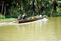 Longboat cruising up the river to the Floating Market near Bangkok, Thailand