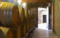 Barrels of wine aging in the cellar Chateau Vannieres (Vannières) La Cadiere (Cadière) d'Azur Bandol Var Cote d'Azur France