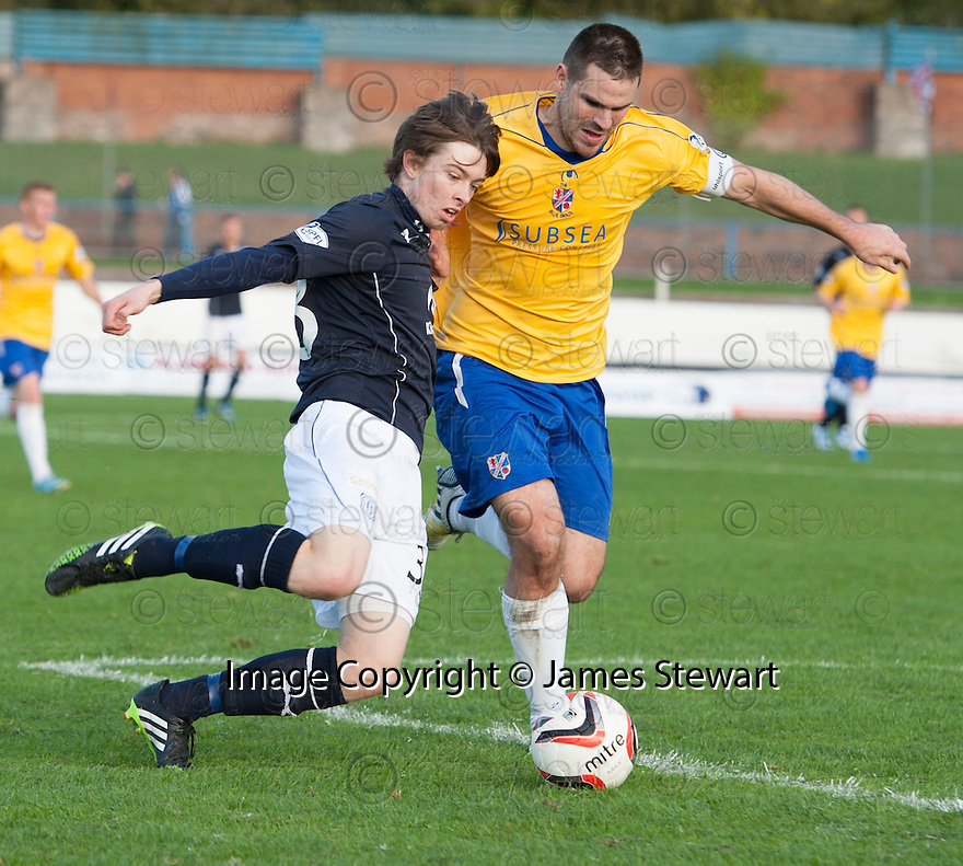 Dundee's Craig Wighton gets a cross in as Cowdenbeath's John Armstrong tries to make the challenge.