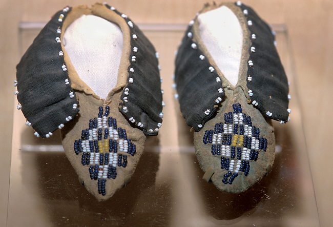 Pair of Caddo Indian children's beaded leather moccasins on display at the Sam Noble Museum of Natural History in Norman Oklahoma