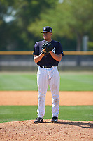 New York Yankees pitcher Tony Hernandez (19) gets ready to deliver a pitch during a minor league Spring Training game against the Detroit Tigers on March 22, 2017 at the Yankees Complex in Tampa, Florida.  (Mike Janes/Four Seam Images)