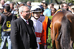 Julien Leparoux gets a leg up from Shug McGaughey in the Keeneland paddock. 04.08.2010
