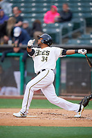 Cesar Puello (34) of the Salt Lake Bees bats against the Albuquerque Isotopes at Smith's Ballpark on April 24, 2019 in Salt Lake City, Utah. The Isotopes defeated the Bees 5-4. (Stephen Smith/Four Seam Images)