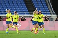 YOKOHAMA, JAPAN - AUGUST 6: Stina Blackstenius #11 of Sweden celebrates scoring with teammates during a game between Canada and Sweden at International Stadium Yokohama on August 6, 2021 in Yokohama, Japan.