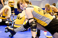 Beatrix Slaughter of the Bronx Gridlock gets ready to clash against the Manhattan Mayhem at a Gotham Girls Roller Derby bout in New York City on May 6, 2006.