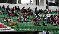 TUNJA - COLOMBIA, 26-09-2021: Hinchas de Patriotas Boyaca F. C., anima a su equipo durante partido entre Patriotas Boyaca F. C. y Deportes Tolima de la fecha 11 por la Liga BetPlay DIMAYOR II 2021 en el estadio La Independencia en la ciudad de Tunja. / Fans of Patriotas Boyaca F. C., cheer for their team, during a match between Patriotas Boyaca F. C. and Deportes Tolima of the 11th date for the BetPlay DIMAYOR II 2021 League at the La Independencia Stadium in Tunja city. / Photo: VizzorImage / Macgiver Baron / Cont.