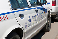 Ville de Quebec city police logo is seen on a police car Friday April 8, 2011.