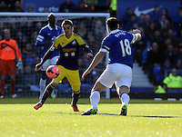 Pictured L-R: Pablo Hernandez of Swansea against Gareth Barry of Everton. Sunday 16 February 2014<br /> Re: FA Cup, Everton v Swansea City FC at Goodison Park, Liverpool, UK.