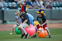 "Young fans take part in the ""Bouncy Ball Jr."" race between innings of the Carolina League game between the Potomac Nationals and the Winston-Salem Dash at BB&T Ballpark on May 13, 2016 in Winston-Salem, North Carolina.  The Dash defeated the Nationals 5-4 in 11 innings.  (Brian Westerholt/Four Seam Images)"